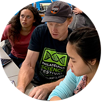 Nicholas Galitzki (seated at center) runs the data with students at the High Bay Lab. Photo courtesy of the Stuart Volkow Photo Collection, High Bay Physics Lab and SAT1