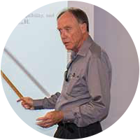 George Fuller emphasizes a point while teaching.